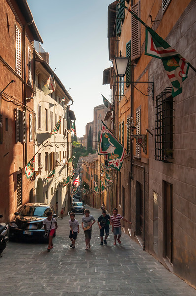 Boys Playing in Street of Old Town of Siena, Tuscany, Italy