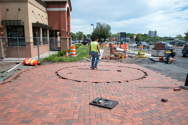 08/27/19 Wesley Bunnell | Staff Martin Laviero Construction lays down brickwork for new sidewalks on the corner of Main and E Main St across from the Bee Hive Bridge on Tuesday August 27, 2019.