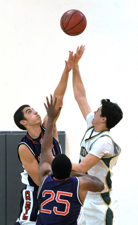 . Sun Devils senior forward Jon Payne (10) went for the block on Machebeuf\'s Devon Garcia (21) in the second half. The Kent Denver High School boy\'s basketball team defeated Bishop Machebeuf 77-75 Tuesday night, January 15, 2013. Karl Gehring/The Denver Post