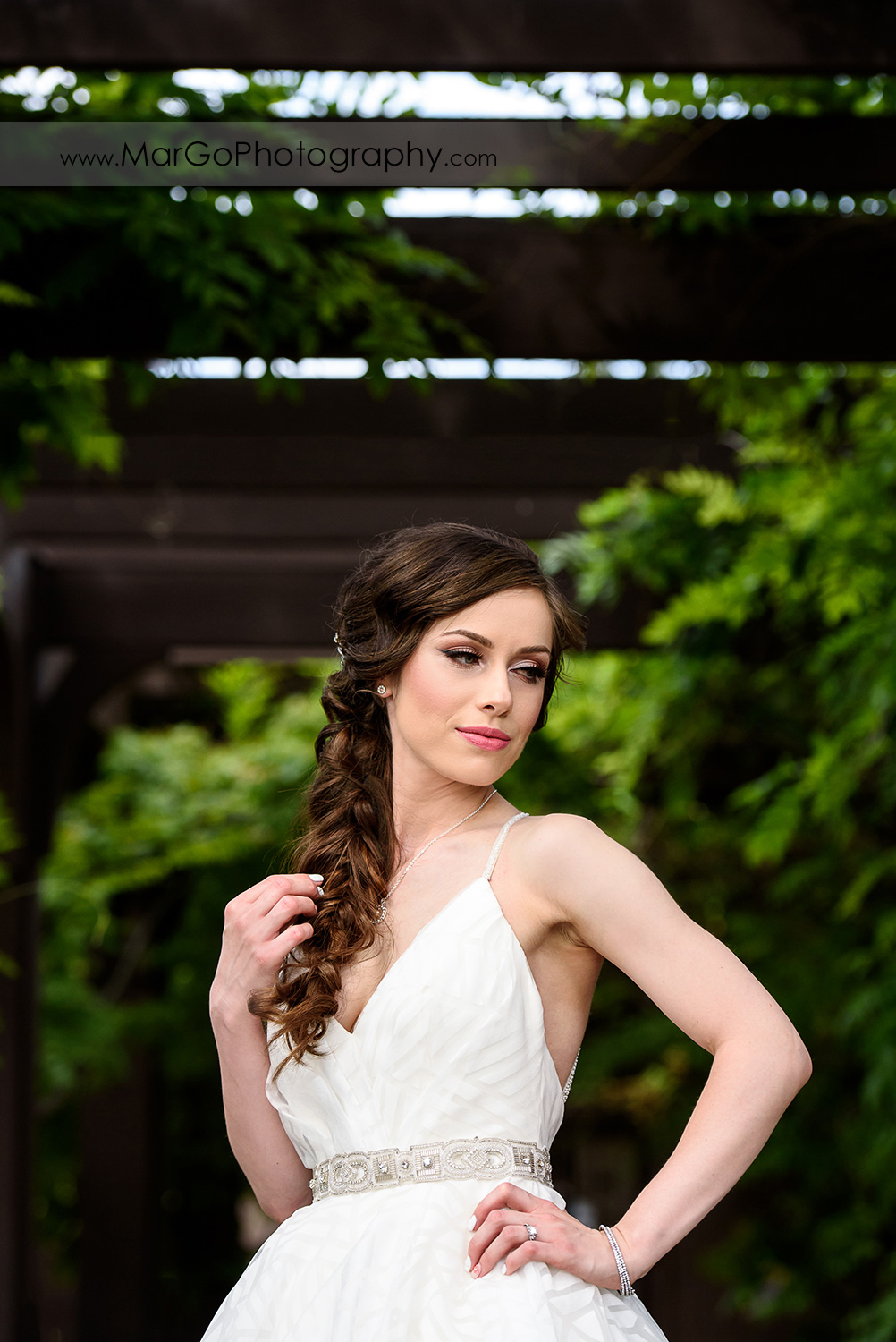 portrait of bride looking right at Saratoga Foothill Club