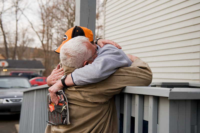 Dad and Michael reunite outside the house where he lives.