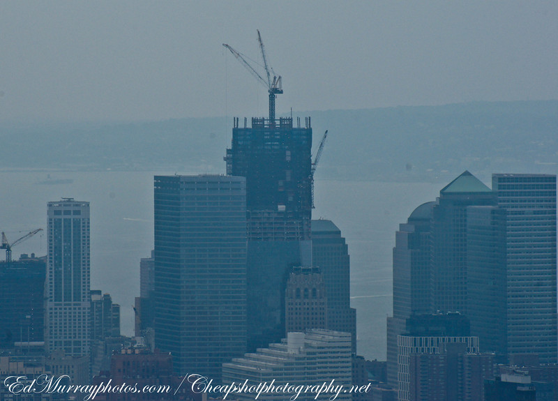 Reclaiming the Skyline: Downtown Manhattan at 3 miles...This is the construction of the new World Trade Center 1 (The Freedom Tower). It was real hazy and overcast but I felt that I needed to post this. Right now, the structural steel is up to the 72nd story...The building in front of it (center) is the 741 foot tall World Trade Center 7 which was completed in 2006. I can't wait to see the tower when it's completed , but, in all honesty, I really do miss the old view.