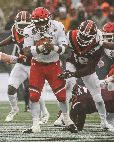 Cincinnati running back #3 Michael Warren II evades Virginia Tech free safety #18 Tyree Rodgers