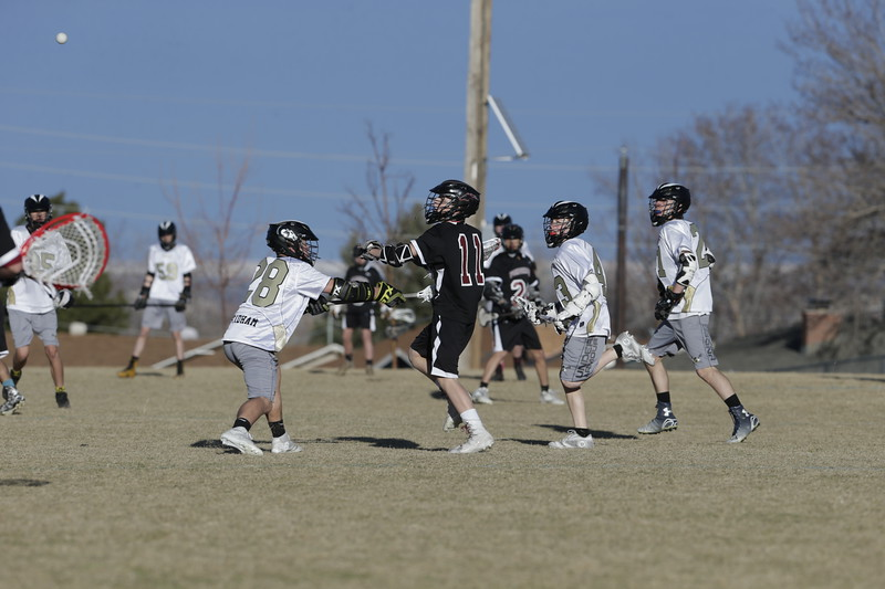 JPM0136-JPM0136-Jonathan first HS lacrosse game March 9th.jpg