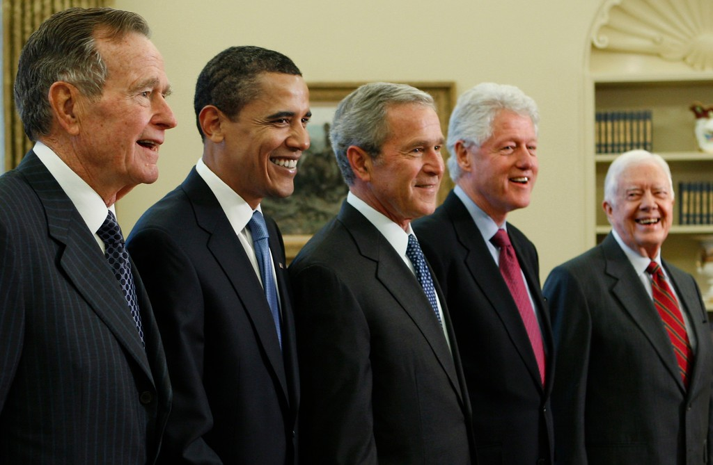 . President George W. Bush, center, poses with President-elect Barack Obama, and former presidents, from left, George H.W. Bush, left, Bill Clinton and Jimmy Carter, right, Wednesday, Jan. 7, 2009, in the Oval Office of the White House in Washington. (AP Photo/J. Scott Applewhite)