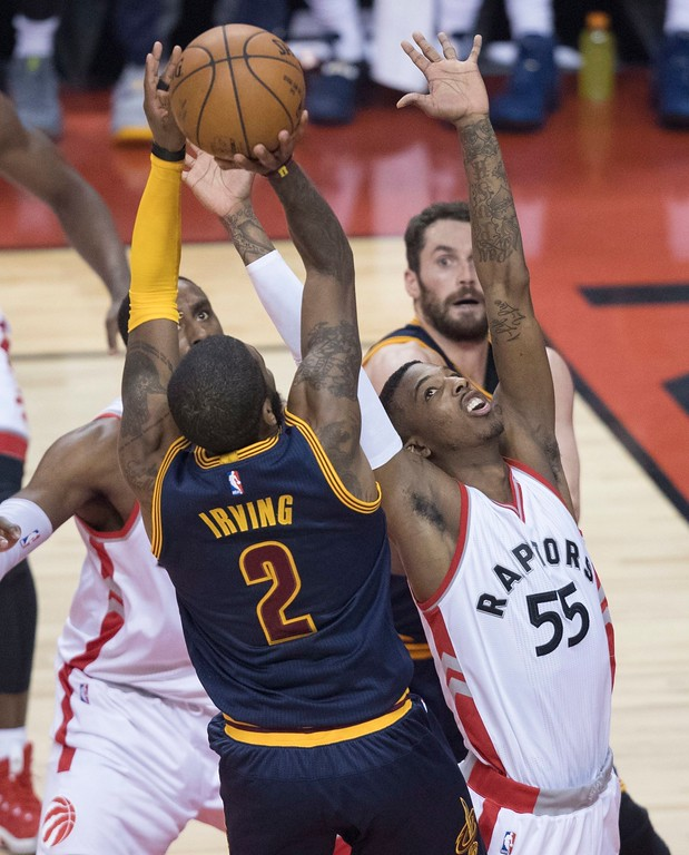 . Cleveland Cavaliers\' Kyrie Irving drives to the basket past Toronto Raptors\' Delon Wright during the first half of Game 3 of an NBA basketball second-round playoff series in Toronto on Friday, May 5, 2017. (Fred Thornhill/The Canadian Press via AP)