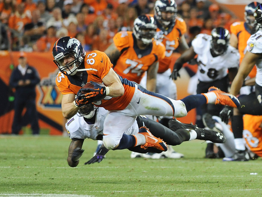 . Denver Broncos wide receiver Wes Welker makes a catch in the third quarter against the Baltimore Ravens at Sports Authority Field at Mile High on September 5, 2013. A holding penalty on the play nullified the gain.(Photo by Steve Nehf/The Denver Post)