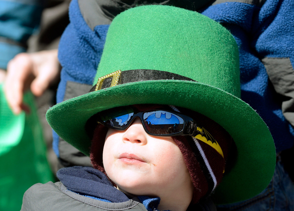 . Maribeth Joeright/MJoeright@News-Herald.com<p> Rocco Coale, 3, of Rocky River, clad in his St. Patrick\'s themed hat and Batman sunglasses watches the 147th annual parade with his family, March 17, 2014.