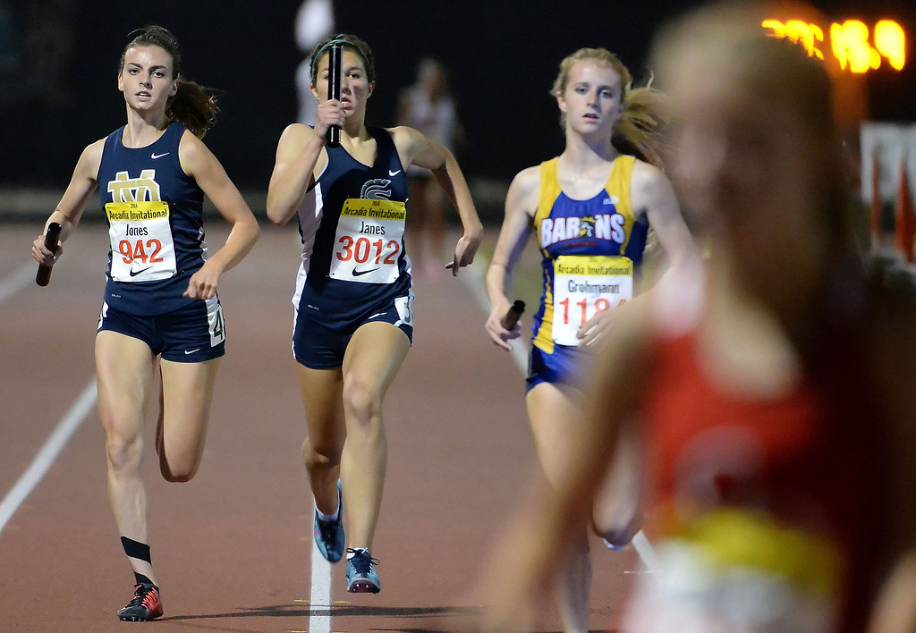. Saugus\' Sabrina Janes, center, runs the final leg of the 4x1600 Meter Relay Invitational during the Arcadia Invitational track and field meet at Arcadia High School in Arcadia, Calif., on Friday, April 11, 2014. Great Oak won the race.  (Keith Birmingham Pasadena Star-News)