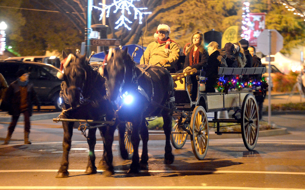 . A horse-drawn carriage gives rides to the Vacaviile Museum from downtown during the 2013 Merriment on Main Celebration. Joel Rosenbaum/JRosenbaum@TheReporter.com