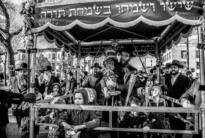 sefer torah parade CH walking with the Torah.jpg