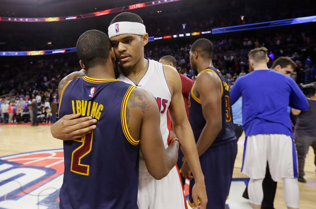 . Cleveland Cavaliers guard Kyrie Irving (2) is hugged by Detroit Pistons forward Tobias Harris after Game 4 of a first-round NBA basketball playoff series, Sunday, April 24, 2016 in Auburn Hills, Mich. The Cavaliers defeated the Pistons 100-98 and swept the series. (AP Photo/Carlos Osorio)