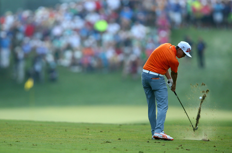 . Rickie Fowler of the United States hits his second shot on the 12th hole during the final round of the 96th PGA Championship at Valhalla Golf Club on August 10, 2014 in Louisville, Kentucky.  (Photo by Jeff Gross/Getty Images)