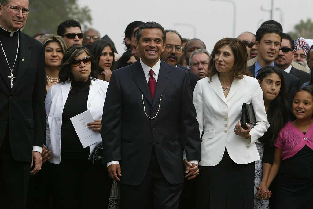 . 7/1/05-LOS ANGELES- Antonio Villaraigosa gets a loving look from his wife Corina as he processes towards City Hall for his swearing in as Mayor. He was inaugurated as Mayor of the city of Los Angeles Friday, with a procession from the Cathedral of Our Lady of Angels to City Hall. He was sworn in by Justice Stephen Reinhardt, from the United States Court of Appeals for the Ninth Circuit, with his wife Corina by his side.  (Los Angeles Daily News file photo)