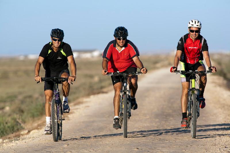 Cyclists on Doñana marshland area, town of Sanlucar de Barrameda, province of Cadiz, Andalusia, Spain.