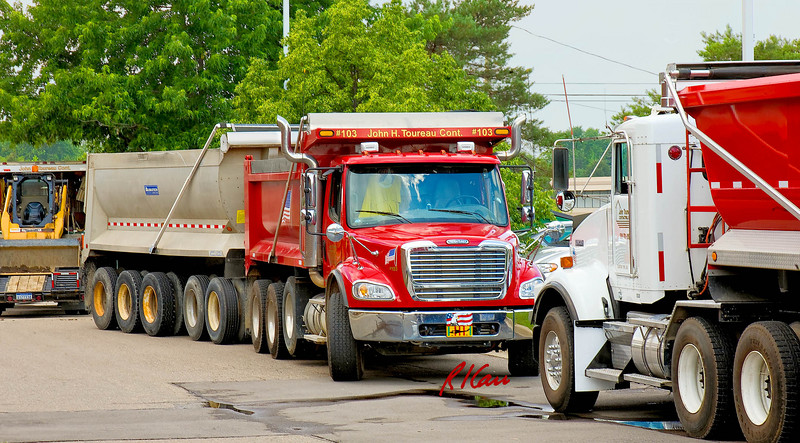 Freightliner dump truck and trailer wait to be loaded. Ann Arbor, Michigan 2007