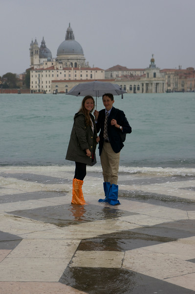 Catherine and Gabe standing in the Aqua Alta of Venice, Italy