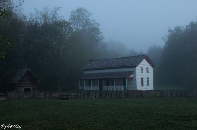 Becky Cable House and  Smokehouse in the early morning fog.