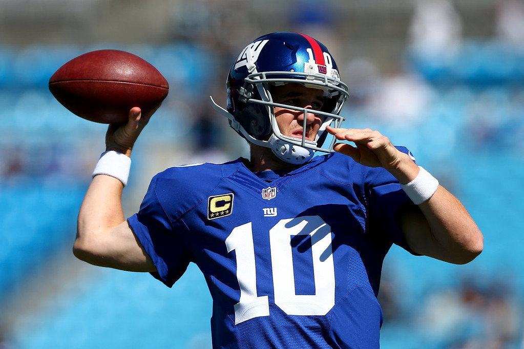 . Eli Manning #10 of the New York Giants warms up before their game against the Carolina Panthers at Bank of America Stadium on September 22, 2013 in Charlotte, North Carolina.  (Photo by Streeter Lecka/Getty Images)