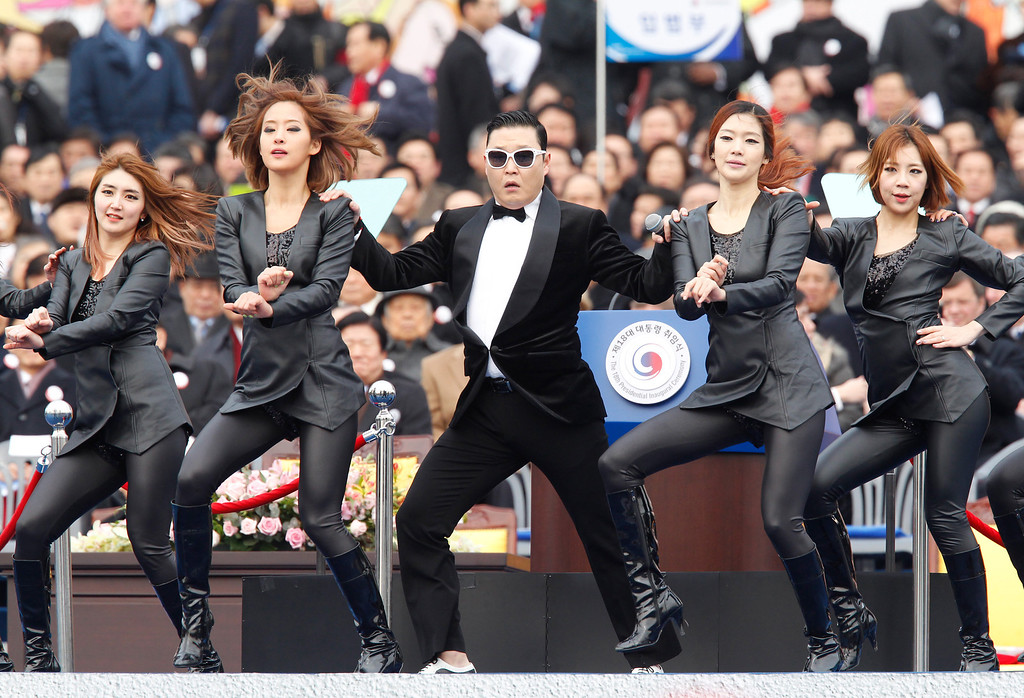 """. Singer Psy (C) performs during the inauguration ceremony of South Korea\'s new President Park Geun-Hye at parliament in Seoul on February 25, 2013. Park Geun-Hye became South Korea\'s first female president on February 25, vowing zero tolerance with North Korean provocation and demanding Pyongyang \""""abandon its nuclear ambitions\"""" immediately.   AFP PHOTO / POOL / Kim Hong-JiKim Hong-Ji/AFP/Getty Images"""