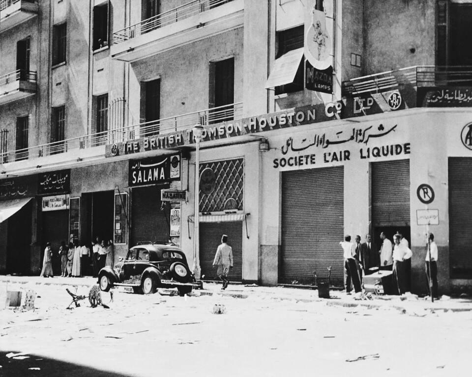 . During the last two days, October 9 and 10, 1952 yelling demonstrators have marched through the Cairo streets shouting Nationalist slogans, threatening the British Embassy and inflicting damage on British and French business premises. The incidents which included the damaging of the offices of the French Air Liquide and the British Thompson Houston Firms, followed the denouncement by the Egyptian Premier Nhas Pasha, of the 1936 treaty which gave Britain certain military rights on the Suez Canal. As a result of the riots police have cordoned off the British Embassy. The British Thompson Houston and French Air Liquide premises are seen locked and guarded after being raided in Cairo, Egypt on Oct. 10, 1951. (AP Photo)