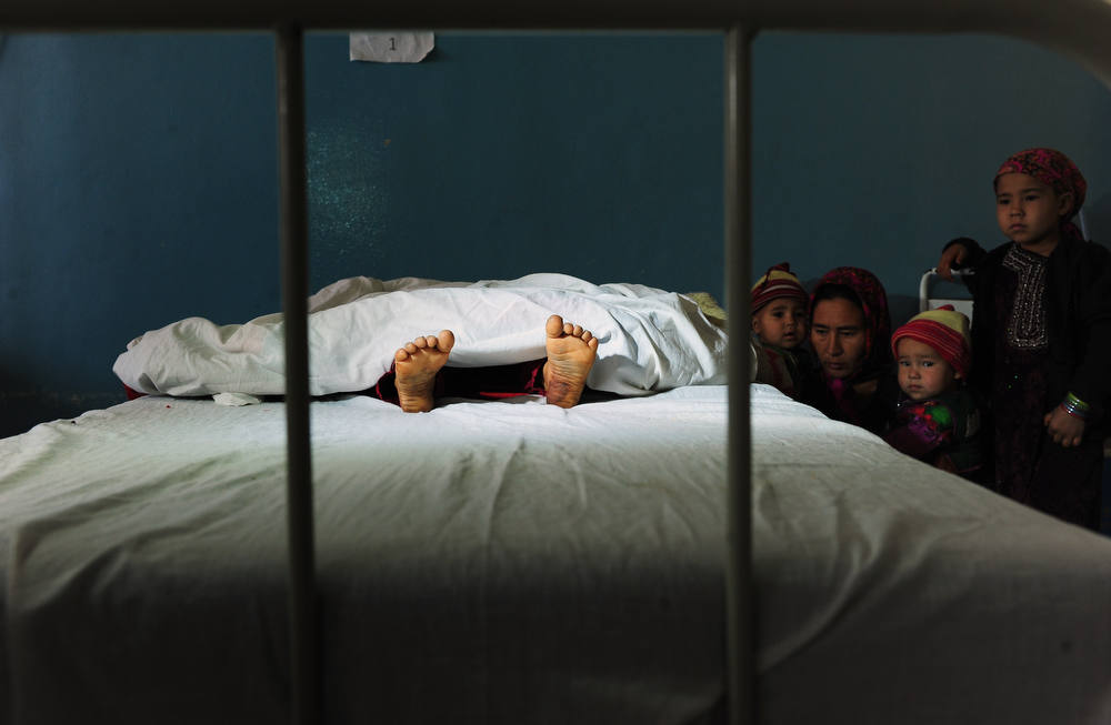 Description of . The family of a five year old Afghan girl, that was allegedly raped by a 22 year old man, looks on as she lies in a hospital bed in Kaldar district of Balk Province of Mazar-i-Sharif on November 12, 2012. The alleged rapist and neighbor was later detained by police. There is little sign that violence against women in Afghanistan is decreasing, despite billions of dollars of international aid which has poured into the country during the decade-long war.  Some 87 percent of Afghan women report having experienced physical, sexual or psychological violence or forced marriage, according to figures quoted in an October report by the British charity Oxfam. AFP PHOTO/ Qais  USYAN/AFP/Getty Images