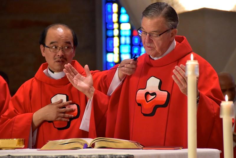 Fr. Mark reads the prayers