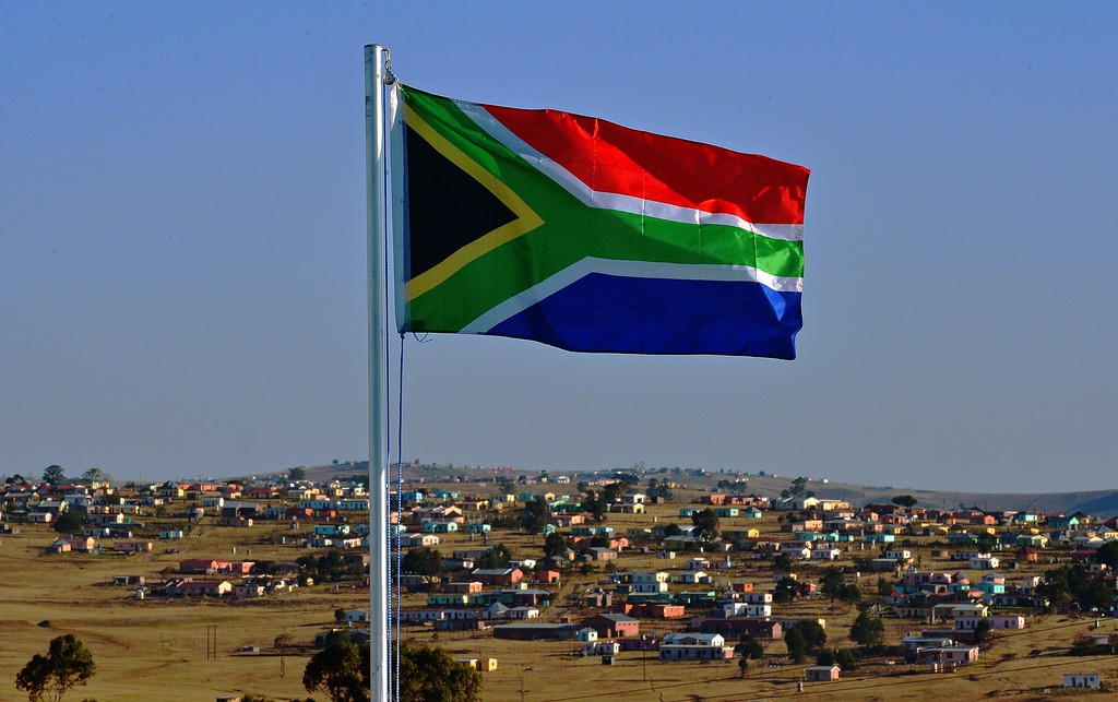 . The South African flag flies near Qunu on June 26, 2013. Qunu is the city where former South African President Nelson Mandela grew up. Mandela remains in critical condition in hospital in Pretoria where he is being visited by family members. CARL DE SOUZA/AFP/Getty Images