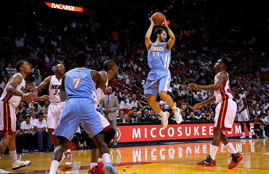 . MIAMI, FL - MARCH 14: Evan Fournier #94 of the Denver Nuggets looks to pass during a game against the Miami Heat at American Airlines Arena on March 14, 2014 in Miami, Florida. (Photo by Mike Ehrmann/Getty Images)