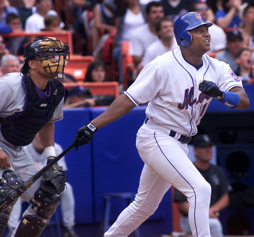 . New York Mets Darryl Hamilton watches his grand slam homer sail out of the park with Colorado Rockies catcher Henry Blanco in the fifth inning at Shea Stadium in New York, Sunday, Sept. 5, 1999.  (AP Photo/Jeff Zelevansky)