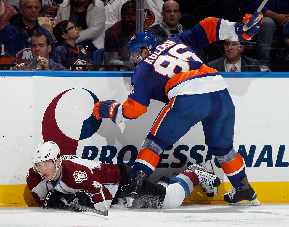 . UNIONDALE, NY - NOVEMBER 11: Matt Duchene #9 of the Colorado Avalanche hits the ice as he attempts to get past Nikolai Kulemin #86 of the New York Islanders during the third period at the Nassau Veterans Memorial Coliseum on November 11, 2014 in Uniondale, New York.  The Islanders shutout the Avalanche 6-0. (Photo by Bruce Bennett/Getty Images)