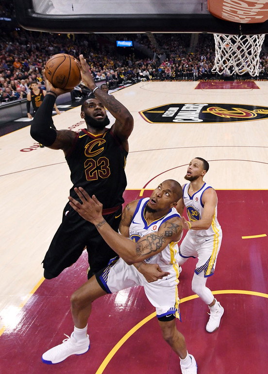 . Cleveland Cavaliers\' LeBron James shoots over Golden State Warriors\' David West during the first half of Game 4 of basketball\'s NBA Finals, Friday, June 8, 2018, in Cleveland. (Gregory Shamus/Pool Photo via AP)