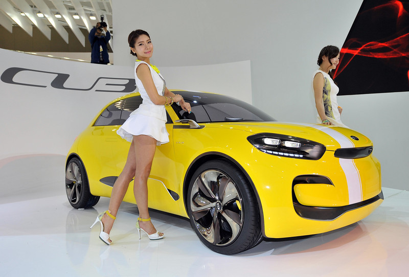 . South Korean models pose with Kia Motors\' concept car CUB during a press preview of the Seoul Motor Show in Goyang, north of Seoul, on March 28, 2013. South Korea\'s largest international auto show will open on March 29, with all Korean car manufacturers showing their latest cars and concepts amongst the 384 companies from 14 countries taking part in the event.  JUNG YEON-JE/AFP/Getty Images