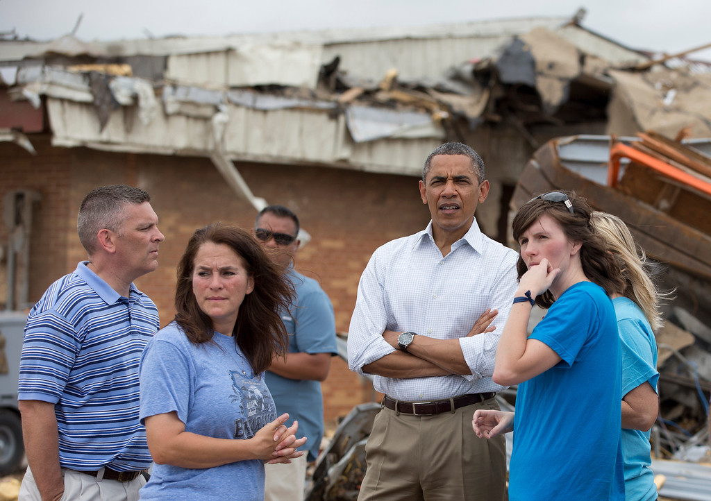 . President Barack Obama views the devastation at  Plaza Towers Elementary School caused by tornado and severe weather last week with school officials, Sunday, May 26, 2013, in Moore, Okla. Second from left is Briarwood Principal Shelley Jaques McMillian. (AP Photo/Carolyn Kaster)