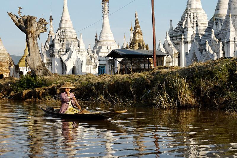 Paddling home at sunset on Inle Lake, Burma (Myanmar).