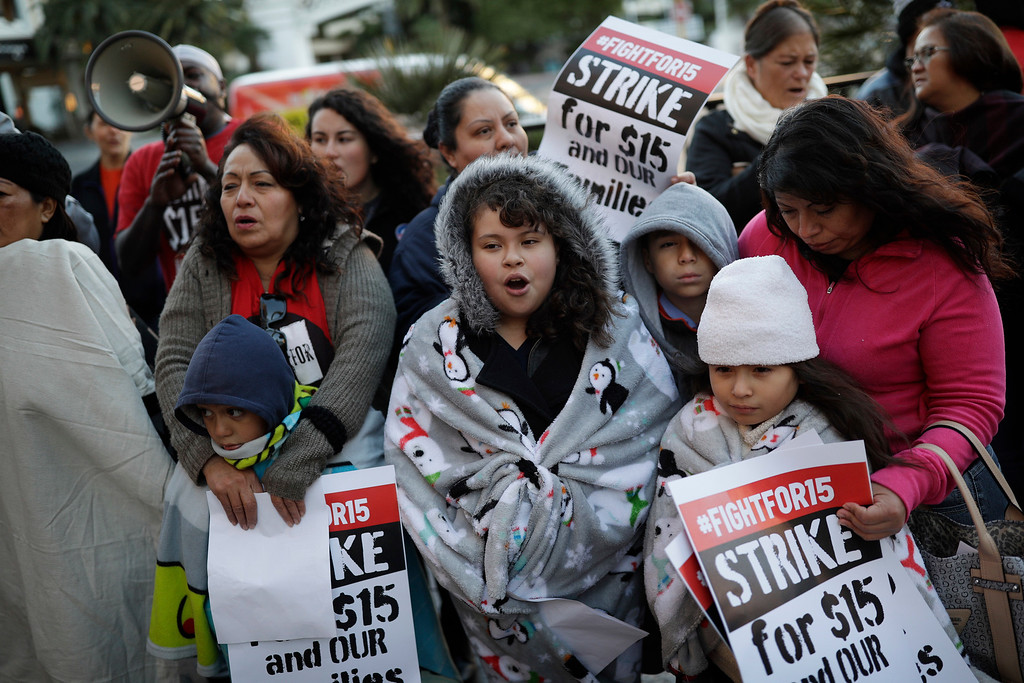 . People protest near a McDonald\'s restaurant along the Las Vegas Strip, Tuesday, Nov. 29, 2016, in Las Vegas. The protest was part of the National Day of Action to Fight for $15. The campaign seeks higher hourly wages, including for workers at fast-food restaurants and airports. (AP Photo/John Locher)
