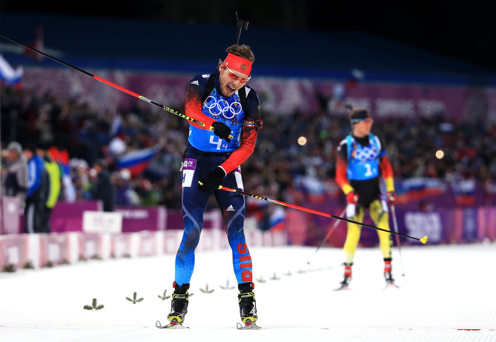 . Anton Shipulin of Russia celebrates winning the gold medal during the Men\'s 4 x 7.5 km Relay during day 15 of the Sochi 2014 Winter Olympics at Laura Cross-country Ski & Biathlon Center on February 22, 2014 in Sochi, Russia.  (Photo by Richard Heathcote/Getty Images)
