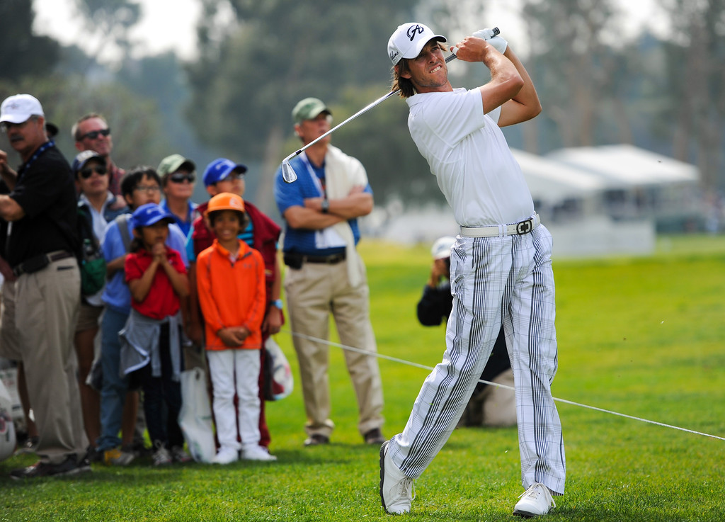 . Aaron Baddeley hits from the gallery after hitting an errant tee shot on the ninth hole during the third round of the Northern Trust Open, Saturday, February 15, 2014, at Riviera Country Club. (Photo by Michael Owen Baker/L.A. Daily News)