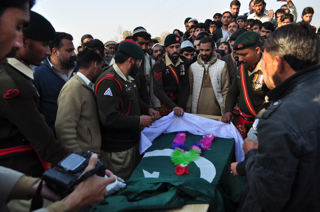 . Pakistani army personnel gather around the coffin of army soldier who was killed in army-run school attack during a funeral in Mansehra on December 17, 2014. Militants rampaged through an army-run school in the northwestern city of Peshawar and killed at least 141 people, almost all of them children, in the bloodiest ever terror  attack in Pakistan.  AFP PHOTO / Adnan  ALI/AFP/Getty Images