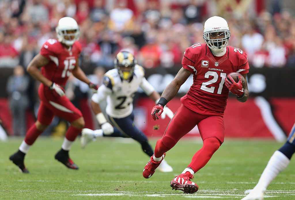 . Wide receiver Patrick Peterson #21 of the Arizona Cardinals runs with the football after a reception against the St. Louis Rams during the NFL game at the University of Phoenix Stadium on December 8, 2013 in Glendale, Arizona.  (Photo by Christian Petersen/Getty Images)