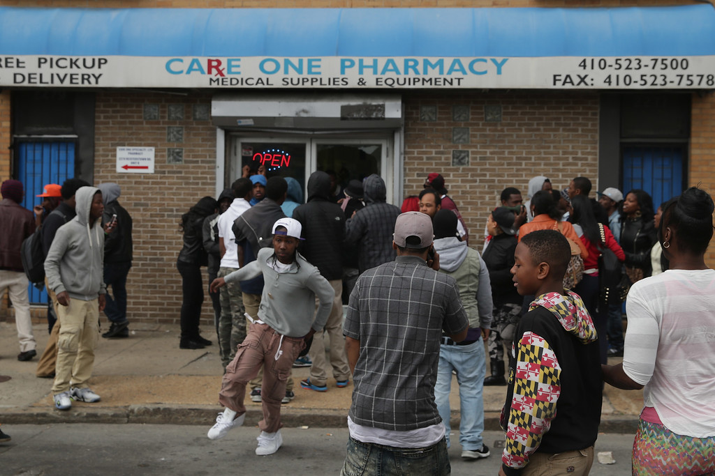 . BALTIMORE, MD - APRIL 27:  People loot a pharmacy along Pennsylvania Ave following the funeral of Freddie Gray April 27, 2015 in Baltimore, Maryland. Gray, 25, who was arrested for possessing a switch blade knife April 12 outside the Gilmor Homes housing project on Baltimore\'s west side. According to his attorney, Gray died a week later in the hospital from a severe spinal cord injury he received while in police custody.  (Photo by Chip Somodevilla/Getty Images)
