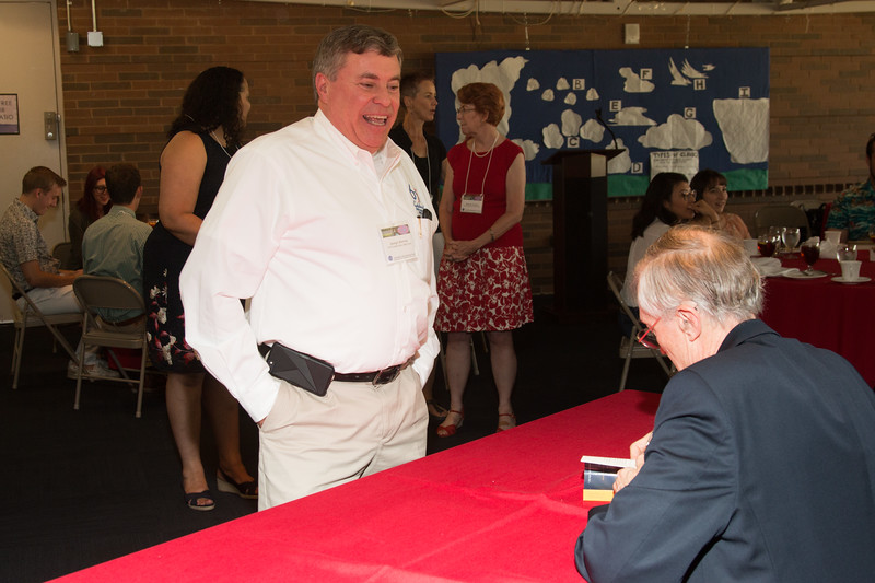 "George Morrow, Acting Center Director, GSFC, with John Mather, as he signs copies of his book ""The Very First Light"" -- An award luncheon, ""Dr. John Mather Nobel Scholars Program Award"", as part of the National Space Grant Foundation. College Park Aviation Museum, College Park, MD, August 2, 2019."