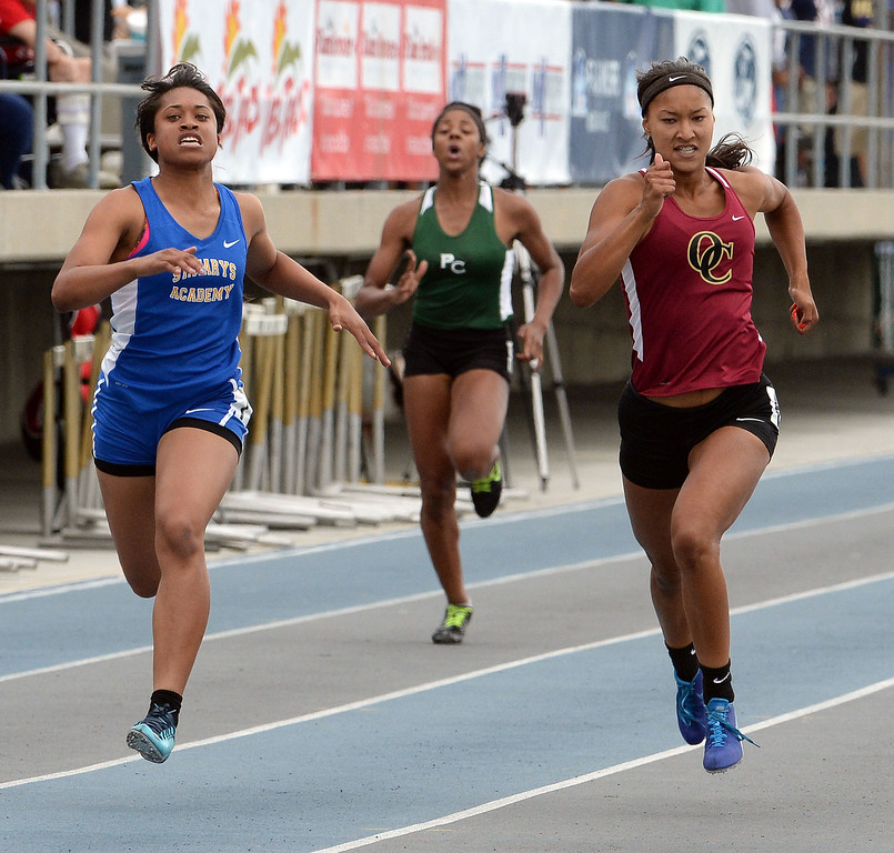 . Oaks Christian\'s Schuyler Moore, center, wins the division 4 200 meters race past St. Mary\'s Academy Sierra Peterson during the CIF Southern Section track and final Championships at Cerritos College in Norwalk, Calif., Saturday, May 24, 2014.   (Keith Birmingham/Pasadena Star-News)
