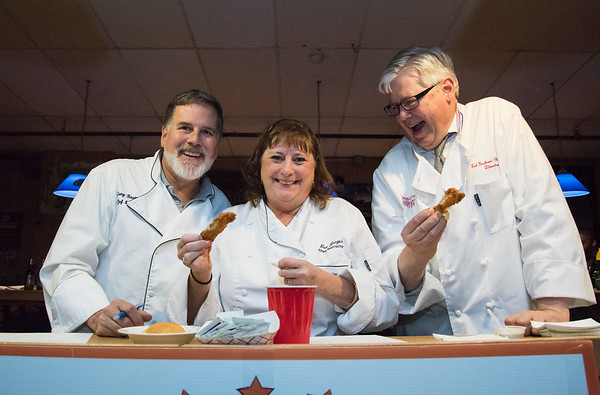 11/19/19 Wesley Bunnell | StaffrrJudges Gary Brummett, L, a retired chef, Lise Jaeger from Chef for Hire LLC and Tad Graham-Handley from Edward Jones enjoy a laugh together during the Southington Chamber of Commerce's annual WingFest at the Cadillac Ranch on Monday night November 18 , 2019.