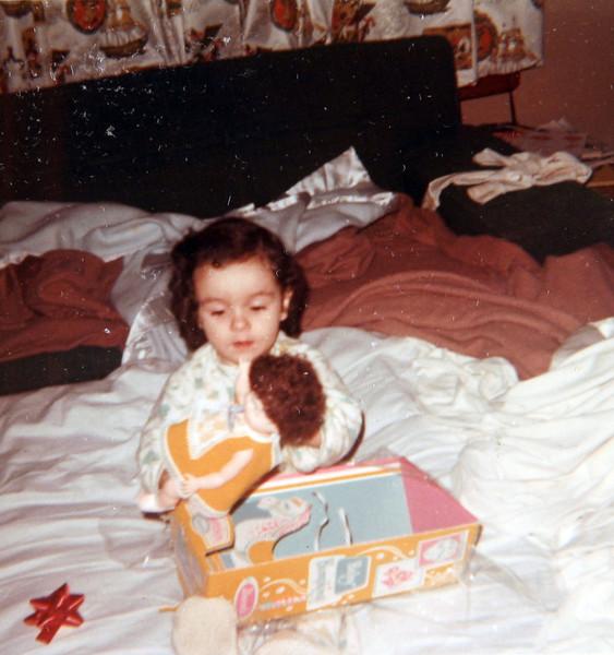 Sherry playing her doll.JPG