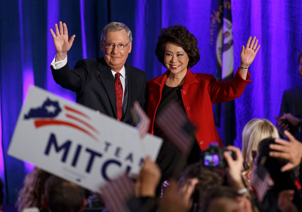 . Senate Minority Leader Mitch McConnell of Ky.,  joined by his wife, former Labor Secretary Elaine Chao, celebrates with his supporters at an election night party in Louisville, Ky.,Tuesday, Nov. 4, 2014. McConnell won a sixth term in Washington, with his eyes on the larger prize of GOP control of the Senate. The Kentucky Senate race, with McConnell, a 30-year incumbent, fighting off a spirited challenge from Democrat Alison Lundergan Grimes, has been among the most combative and closely watched contests that could determine the balance of power in Congress. (AP Photo/J. Scott Applewhite)