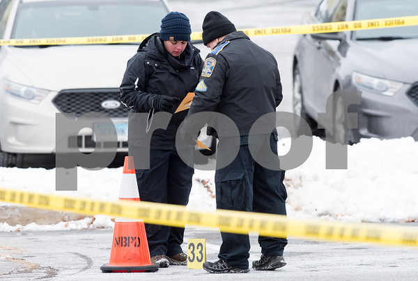 12/15/17 Wesley Bunnell | Staff State and New Britain Police on Friday morning at the intersection of Chapman St and Chapman Ct where an officer involved shooting occurred on Thursday evening involving three suspects in a green Toyota.