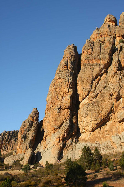 That's Marikki's first climb up the middle peak. Look closer, and you'll find Marikki standing at the bottom of the cliff. Look. Closer. Yes, there she is. Mt. Arapiles, Victoria, Australia. Photography by Trent Williams.