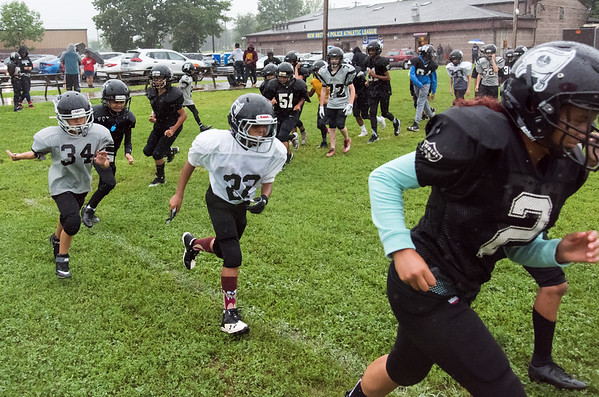 08/13/18 Wesley Bunnell | Staff New Britain PAL Raider teammates run laps during a heavy rain on Monday afternoon during team practice.