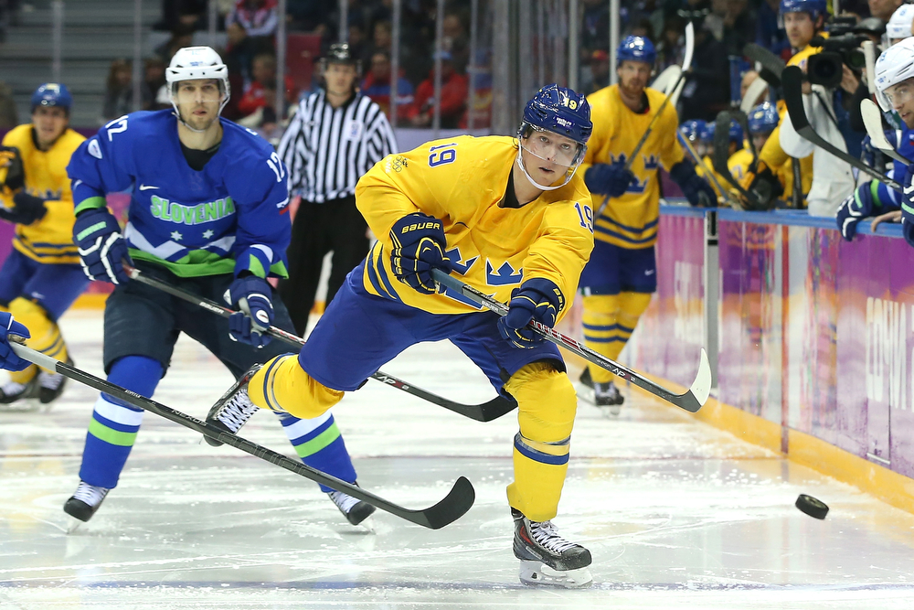. Nicklas Backstrom #19 of Sweden fires the puck against David Rodman #12 of Slovenia in the third period during the Men\'s Ice Hockey Quarterfinal Playoff on Day 12 of the 2014 Sochi Winter Olympics at Bolshoy Ice Dome on February 19, 2014 in Sochi, Russia.  (Photo by Bruce Bennett/Getty Images)